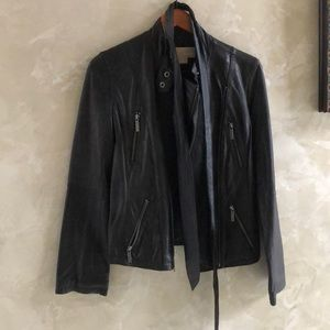 Black Michael Kors leather jacket.